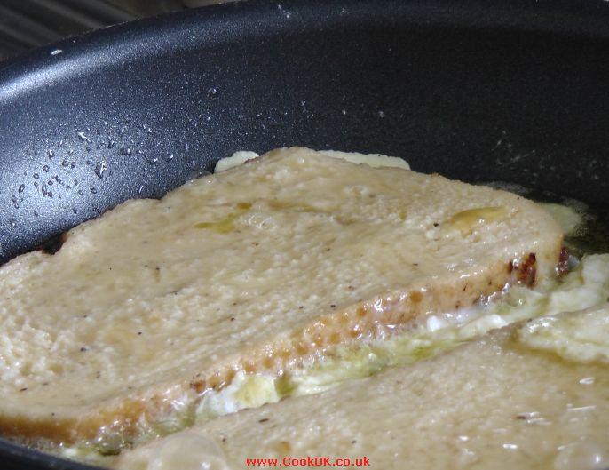 Eggy Bread Frying In A Pan