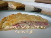 A slice of ham and gruyere cheese galette