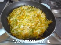 Frying the leeks, onions and carrots