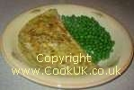 Omelette and peas on a plate