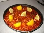 Chicken Paella with lemon wedges