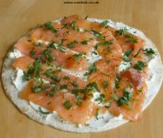 Tortilla covered with cream cheese and smoked salmon
